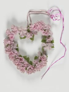 Heart-shaped artificial flower wreath, Manchester Together Archive
